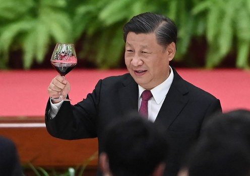 Chinese President Xi Jinping raises his glass after a speech by Premier Li Keqiang at a reception at the Great Hall of the People in Beijing on the eve of China's National Day,  Sept. 30, 2021.