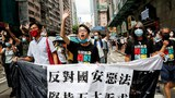 Hong Kong Police Charge Eight Pro-Democracy Figures Over July 1 Protest