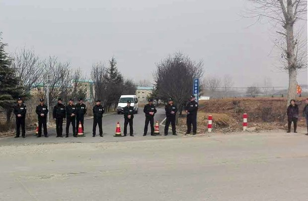 china-zhaoyuan-detention-center-police-march-2017.jpg