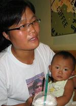 Yuan Weijing with her daughter in Beijing, July 04, 2007. Photo: Hu Jia