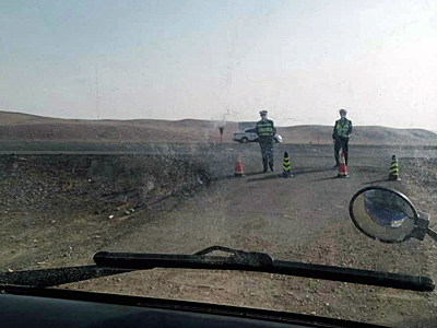 Police stop a vehicle at a roadblock in Inner Mongolia's Zaruud Banner amid pollution protests by local herding communities, April 2016. Photo courtesy of a protester