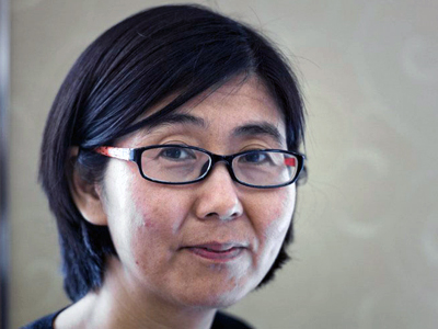 Chinese human rights lawyer Wang Yu gives an interview in Hong Kong, March 20, 2014. Credit: AFP