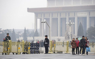Security guards monitor Tiananmen Square ahead of the CPPCC in Beijing, March 2, 2012.