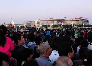 Crowds gather on China's National Day, Oct. 1, 2012, in Beijing in front of the Great Hall of the People where the 18th Party Congress will be held next month.