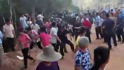 A screen grab from a video shows Feilaixia villagers clashing with police on May 8, 2017.