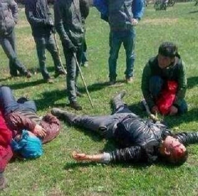 Herders beaten unconscious in the clash lie on the ground, May 17, 2013. Photo courtesy of SMHRIC.