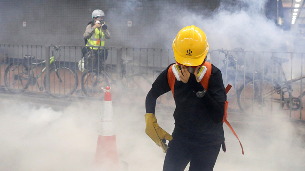 A protester shields himself from tear gas during a confrontation with police in Tai Wai, Hong Kong, Aug. 10, 2019. (Reuters Photo)