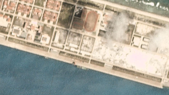 Closer view of satellite image taken March 19, 2020, over the Chinese-occupied base at Mischief Reef, showing a large vessel at the quayside.