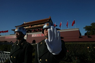 A paramilitary policeman stands guard at Tiananmen Square in Beijing on Nov. 13, 2012 during the 18th Party Congress.