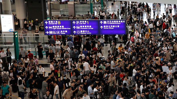 Protesters crowd Hong Kong International Airport on July 26, 2019. (AFP Photo)