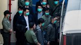 Hong Kong pro-democracy activists are escorted to a police van a day after appearing at the West Kowloon Court in Hong Kong, March 2, 2021.