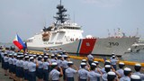 Philippine Coast Guard personnel in Manila salute the US Coast Guard National Security Cutter Bertholf as it arrives for a port call in the first visit by a US cutter in more than seven years, May 15, 2019.