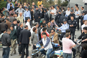 Chinese residents gather outside the city government offices in Ningbo, Oct. 29, 2012.