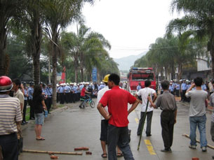 Villagers and police in a standoff, May 23, 2009. Photo provided by local villager