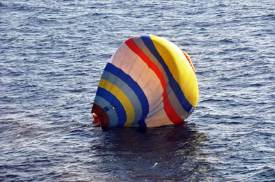 A hot air balloon carrying a Chinese man lands on the water south of the Senkaku/Diaoyu islands in the East China Sea, Jan. 1, 2014. Credit: AFP PHOTO / JAPAN COAST GUARD