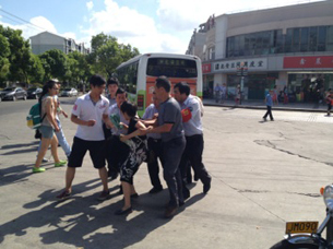 Shanghai petitioner Di Meidi is pushed by security guards, July 31, 2012.