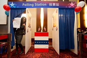 A woman poses after placing a mock vote on Nov. 7, 2012 at an election night party in Beijing organized by the U.S. Embassy.