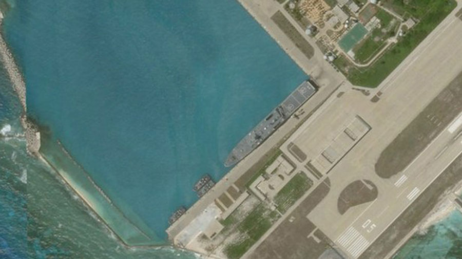 Satellite imagery shows what appears to be an amphibious assault transport ship of the Chinese Navy docked at Woody Island in the South China Sea, June 27, 2020.
