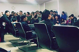 Striking workers at the Foxconn factory in Beijing negotiate with management, Jan. 2013.