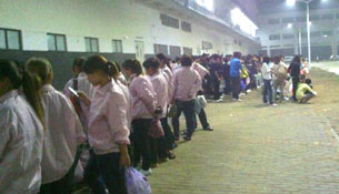 An undated photo shows workers at the Foxconn plant in Zhengzhou.