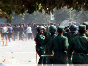 Riot police move to confront protestors demanding government intervention in a land dispute in Longnan, Gansu Province. Photo: RFA Volunteer