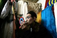 Dancer applies makeup before performing at a gay bar in Wuhan, Nov. 29, 2007. AFP