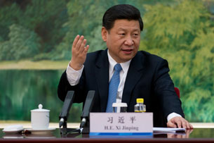 Xi Jinping attends a meeting with 'foreign experts' at the Great Hall of the People in Beijing, Dec. 5, 2012.