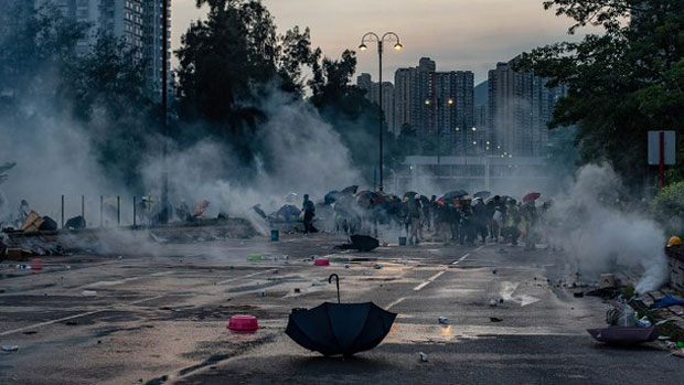 Protesters react after police fire tear gas in Hong Kong's Tai Po district during a general strike, Aug. 5, 2019. (AFP Photo)