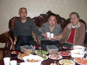 Hada (l) shares a meal with son Uiles (c) and wife Xinna (r) in this photo dated Dec. 10, 2010.