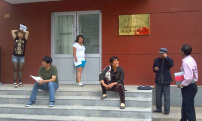Family members of the six detained herders wait to appeal the Inner Mongolia Letter and Visitation Center in Hohhot. Credit: SMHRIC