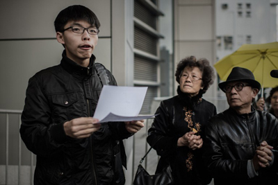 Student activist Joshua Wong speaks outside the Wanchai police station in Hong Kong, Jan. 16, 2015. (Credit: AFP)
