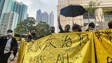 Protesters rally outside a Hong Kong court as the authorities charged 47 pro-democracy activists picked up in mass arrests at the weekend, March 1, 2021.