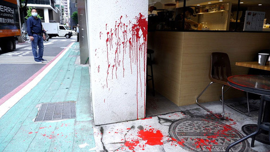 Scene where bookseller Lam Wing-kei was splashed with red paint at a coffee shop close to the crowd-funded bookstore he plans to open in Taipei this week, April 21, 2020.