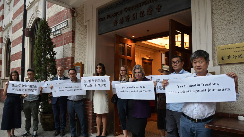 Members of the Foreign Correspondent's Club (FCC) hold a silent protest in Central district in Hong Kong, Sept. 18, 2019. (Photo: AFP)