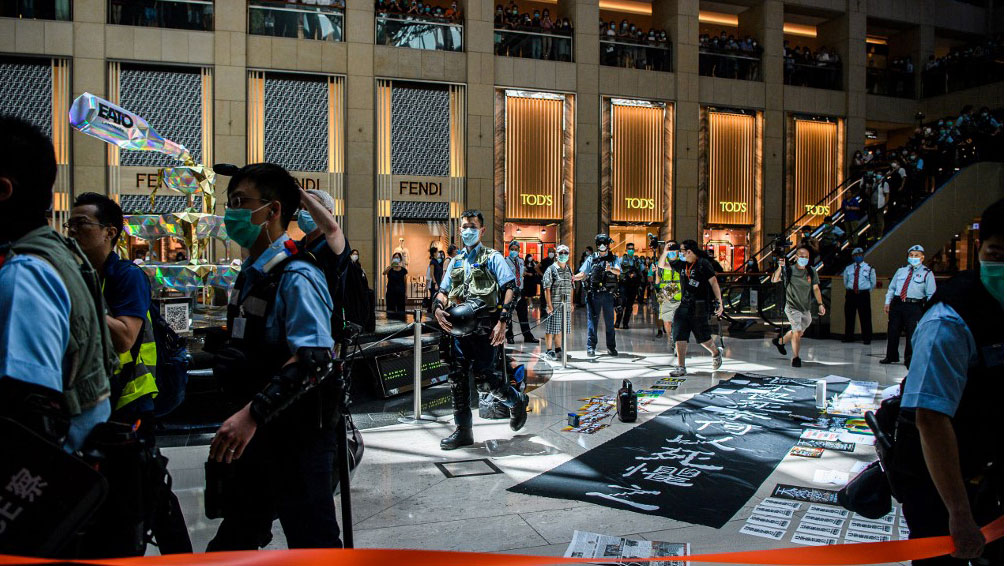 Police enter a shopping mall to disperse people attending a lunchtime rally in Hong Kong on as China passed a sweeping national security law for the city, June 30, 2020.