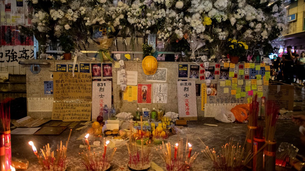 Insence and flowers at a makeshift shrine outside the Mongkok district police station in Hong Kong, where anger continued to mount over the police shooting of a teenage protester, Oct. 3, 2019.(Photo: AFP)