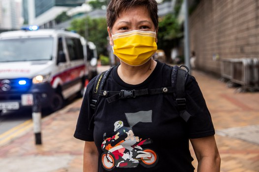 A supporter of Tong Ying-kit wears a t-shirt showing an illustration of Tong's act outside the High Court in Hong Kong, following Tong's conviction in the first trial conducted under a national security law imposed by China, July 27, 2021. Credit: AFP
