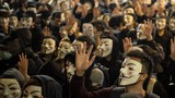 Protesters wear Guy Fawkes masks as they gather in the Kowloon district of Hong Kong, Nov. 5, 2019.