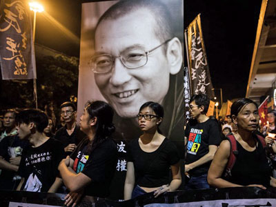 People attend a candlelight march for late Chinese Nobel laureate and pro-democracy dissident Liu Xiaobo in Hong Kong, July 15, 2017.