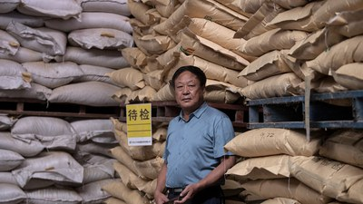Chinese agricultural magnate Sun Dawu is shown at a feed warehouse in Hebei in a file photo.