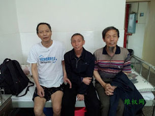 Fellow activists visit Li Wangyang (far left) in an undated photo.