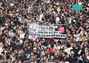 Thousands of protesters demonstrate in Hong Kong on June 10, 2012 over the death of dissident Li Wangyang.