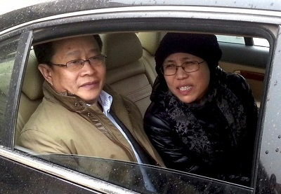 Liu Xia (r) and rights lawyer Mo Shaoping (l) arrive at court for her brother's trial in Beijing, April 23, 2013. Photo credit: AFP.