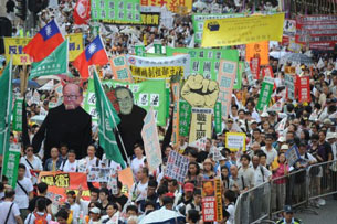 Protesters rally in Hong Kong, July 1, 2011.