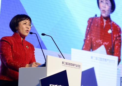 Hu Shuli, founder of Caixin Media, addresses the Caixin Summit in Beijing, Dec. 4, 2016.