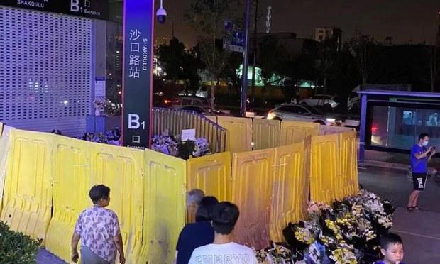 Police Stop Mourners Laying Wreaths Near Flood-Hit Zhengzhou Metro Tunnel