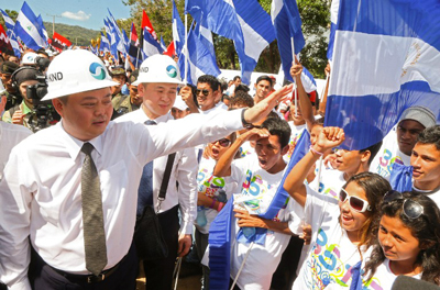 Chinese businessman Wang Jing (L) of HKND greets members of the Sandinista National Liberation Front at the canal project's groundbreaking ceremony in Tola, Nicaragua, Dec. 22, 2014. Credit: AFP