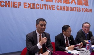 Leung Chun-ying (l) speaks as the other chief executive candidates Albert Ho (c) and Henry Tang (r) look on at a forum in Hong Kong, March 12, 2012.