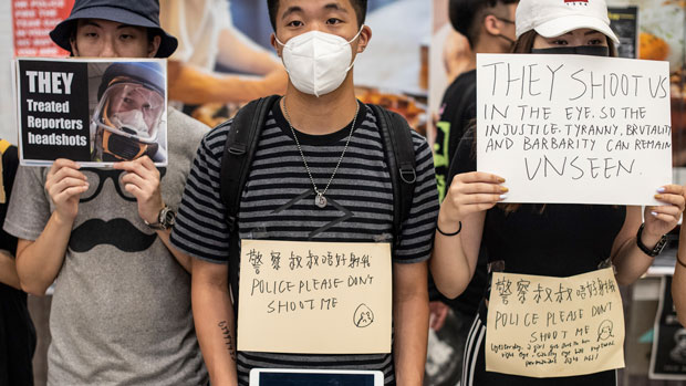 Protesters hold placards at Hong Kong's International Airport, Aug. 12, 2019. (AFP Photo)
