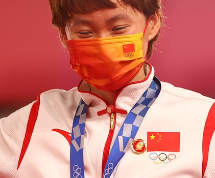 Gold medalist Zhong Tianshi wears a badge of the late Chinese chairman Mao Zedong on the medal ceremony at the Tokyo Olympics, in Shizuoka, Japan, Aug. 2, 2021. Credit: Reuters